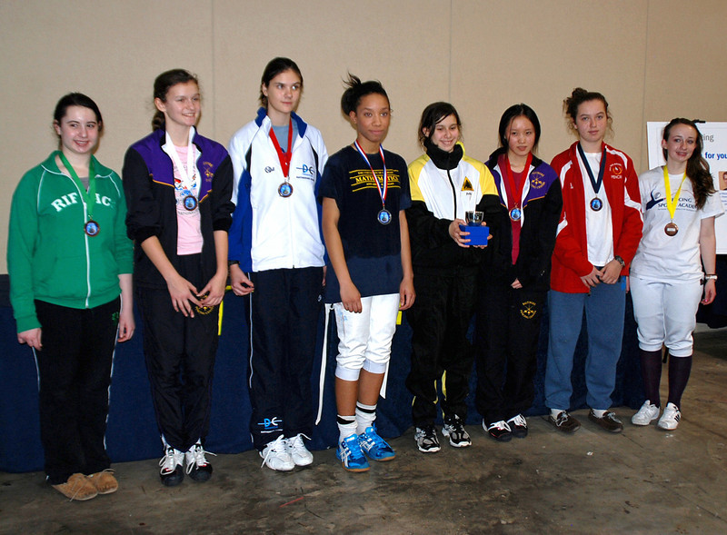 The finalists in Cadet Women's Epee.  From left: Lucy Friedmann (7th), Celine Shanosky (5th), Katherine Sizov (3T), Caira Moreira-Brown (2nd), Julia Smith (1st), Annie Yang (3T), Lily Young (6th) and Chandler Coble (8th),