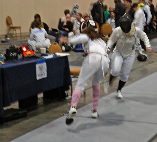 Elizabeth Wiggins scores in the Cadet Women's Epee.