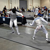 Grant Anderson (right) competes in the Youth-14 Men's Foil.