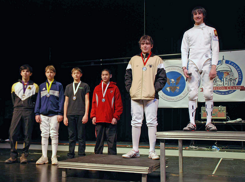 The finalists in Y14 Men's Epee, from left: Daniel Wiggins (8th), Anton Piskovatskov (7th), Charles Horowitz (6th), Harry McGuire (5th), Mitchel Revich (3rd), Inaki De Guzman (3rd), Dean Ischiropoulos (2nd), and Dominic Beecham (1st).  (Two fencers not pictured.)