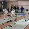 Jared Rosen (right) on the near strip and Jacob Drozdowski (left) on the far strip in Y12 Men's Epee.