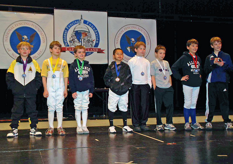 The finalists in Y10 Men's Epee.  From left: Carter Tate (8th), Benjamin Farber (7th), Ethan Green (6th), Tristan Yang (5th), Christopher Parcel (3rd), Elias Cole (3rd), Nicolas Wilson (2nd), and Sean Wilson (1st).