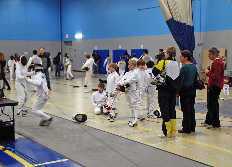 The Y12 CCFC men's epee fencers warm up before the tournament starts.