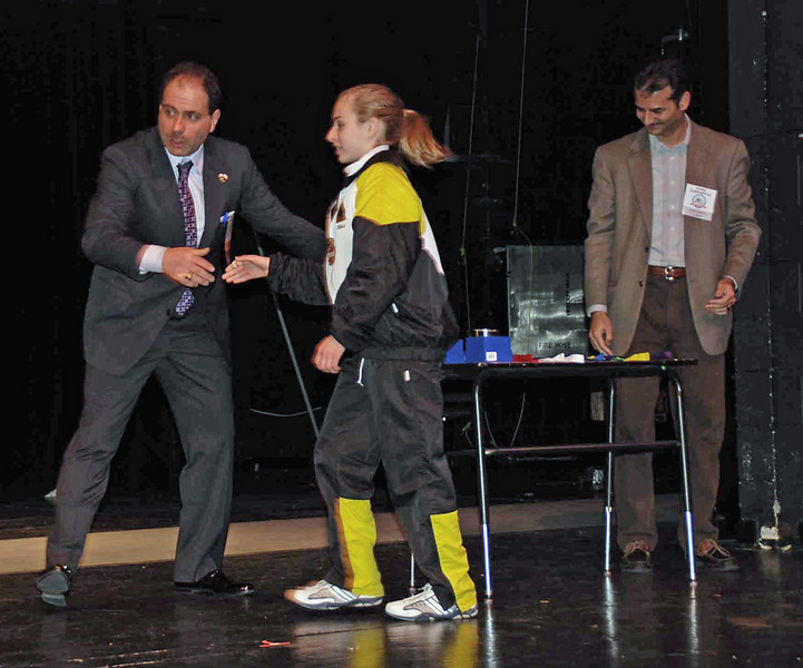 Olivia Morreale gets congratulations from Alexandre Ryjik.