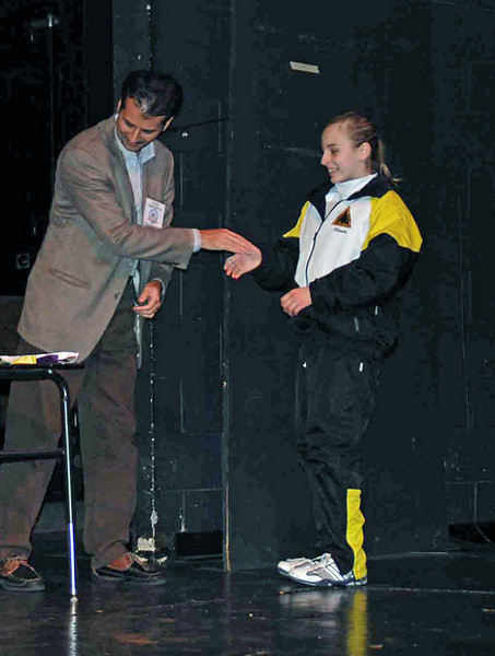 Olivia Morreale receives her 3rd place medal from Sunil Sabharwal, USA representative on the Executive Committee of the Federation Internationale d'Escrime.