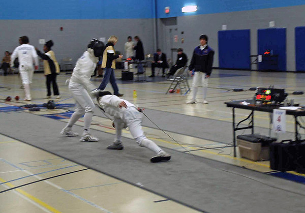 Daniel Wiggins (right) in the Y14 Men's Epee.
