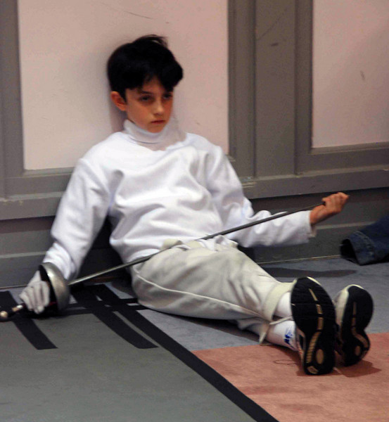 Romain Hufbauer between bouts in the Y10 Men's Epee.
