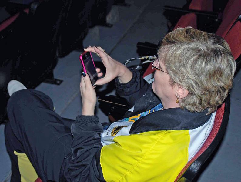 Coach Jean Finkleman checking Facebook.