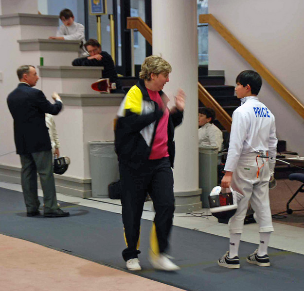Coach Jean Finkleman gives last minute advice to Cameron Price in the Y12 Men's Epee.