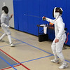 Raphael Hviding (right) in the Y14 Men's Epee.
