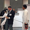 Referee Jim Murray checks the epee of Seth Flanagan in the Y14 Men's Epee.