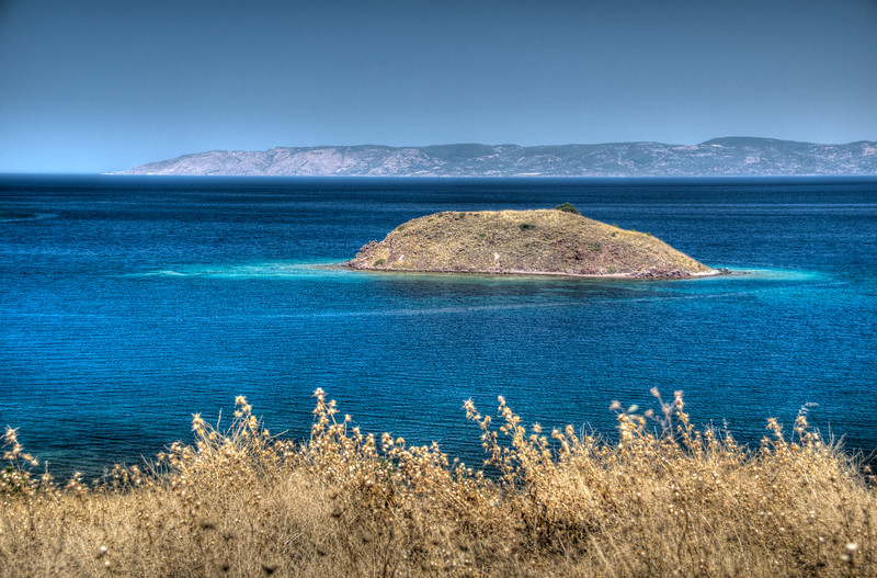 Island off Petra Beach, Lesvos, Greece. Turkish coast in the background.