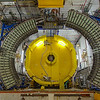 The arcs are muon detectors and the yellow steel absorbs unwanted particles like electrons thereby improving the signal-to-noise ratio of the chamber.