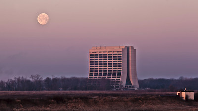 Moon setting behind Fermilab's Wilson Hall.