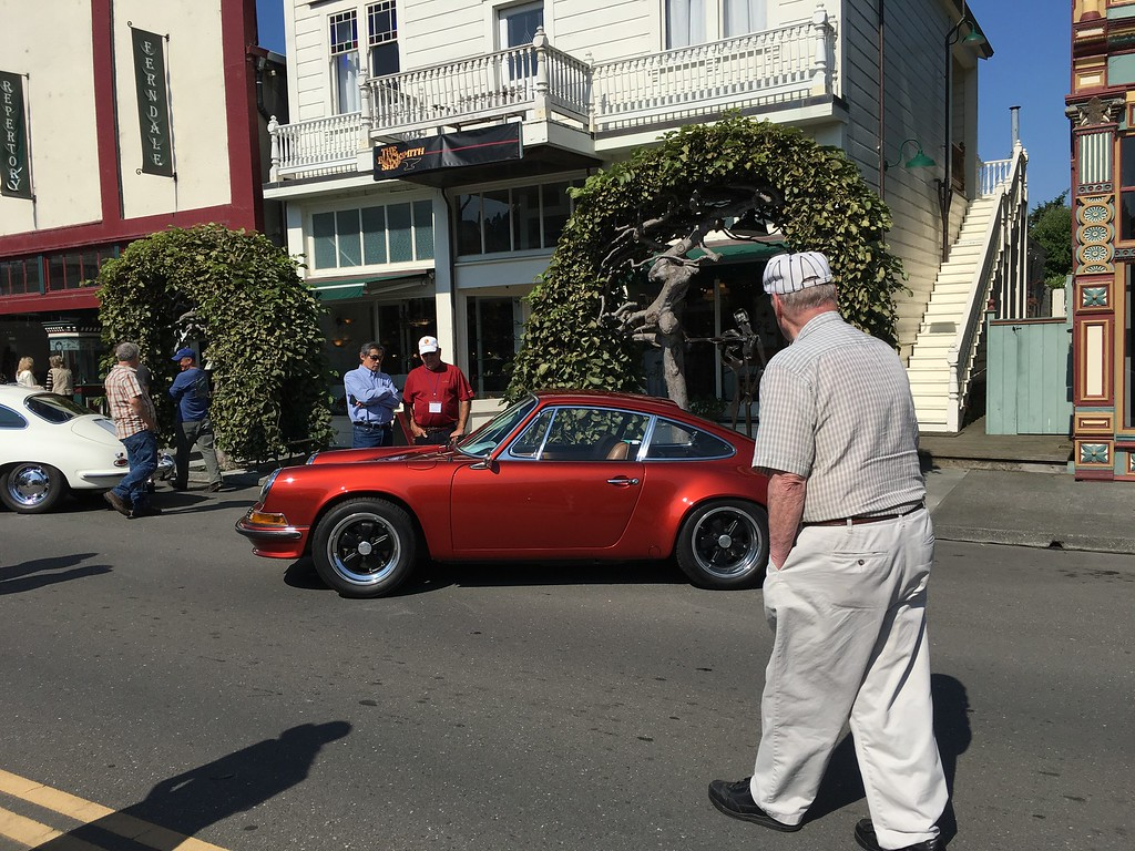 . A passerby eyes a sparkly Porsche on Main Street that was on display for the Ferndale Concours.(Ruth Schneider - The Times-Standard)