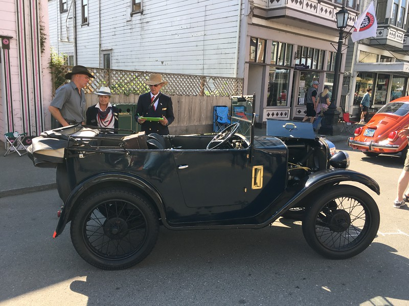 Judges examine a 1930 Austin owned by Craig and Anne Titchner of Eureka. (Ruth Schneider - The Times-Standard)