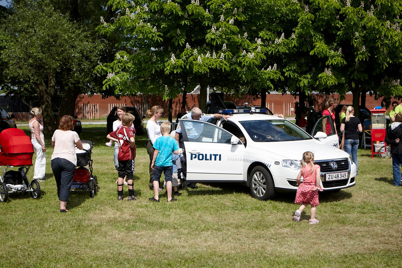 "Funny to see that the ""Politi Bil"" is attracting more kids than 20 Ferraris. In few years all this kids will try to avoid to have chat with the police. I am wondering if ""Skat bil"" will have the same succes !!!"