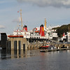 Isle of Arran tied up for night at layover berth on Rothesay pier with Argyle at linkspan