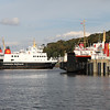 Isle of Arran tied up for night at layover berth on Rothesay pier with Argyle approaching linkspan