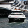 Fast ferry Saint Mary Mackillop with   Zaandam at Sydney cruise terminal