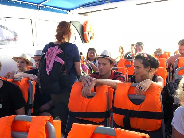 Passengers seated on the speedboat