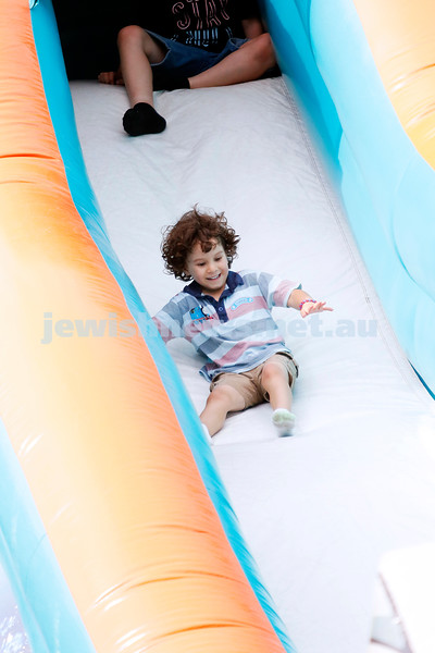 9-12-18. Festibayit. Annual Israeli chanukah festival at Beth Werizmann. Happiness is a big slide. Photo: Peter Haskin