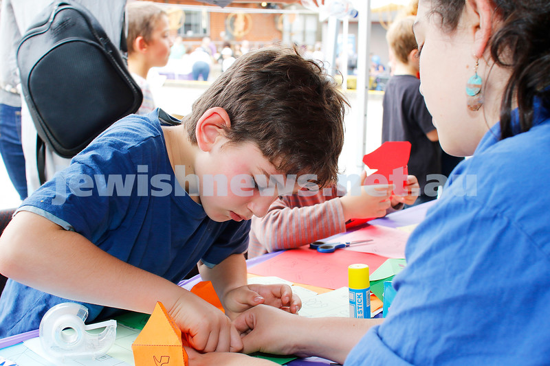 9-12-18. Festibayit. Annual Israeli chanukah festival at Beth Werizmann. Working on making a paper dradel. Photo: Peter Haskin