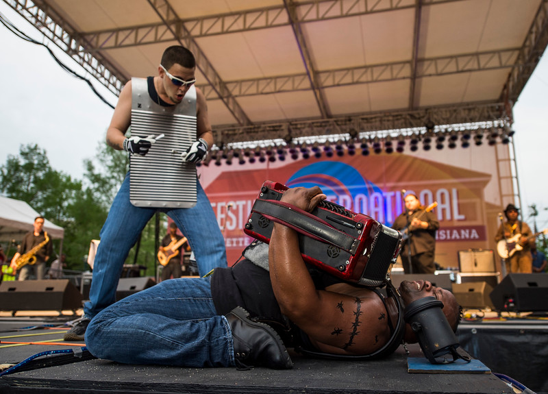 Dwayne Dopsie leans back on a platform as he and his band, the Zydeco Hellraisers, perform on the Scéne Lafayette General Fais Do Do stage during Festival International de Louisiane in Lafayette, LA, Wednesday, April 22,2015.