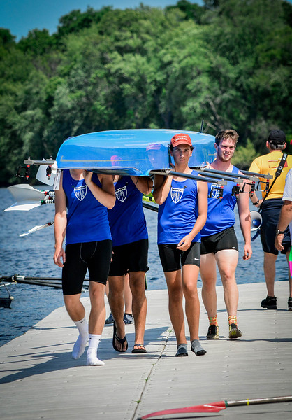 Lake Quinsigamond Community Rowing of Worcester bring their boat in after competing in the Festival Regatta in Lowell. SUN/Caley McGuane