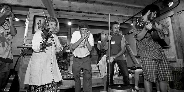 A jam session going on in the Hugh Mangum Photo Museum at the 2008 Festival for the Eno. -2198