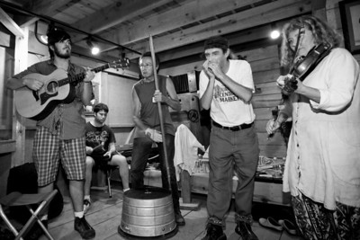 A jam session going on in the Hugh Mangum Photo Museum at the 2008 Festival for the Eno. -2197