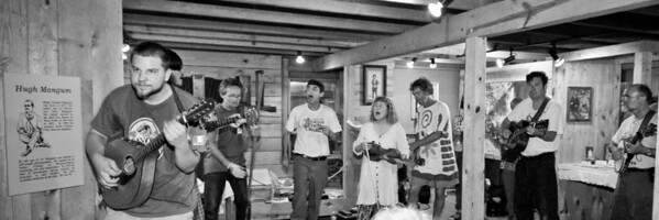A jam session going on in the Hugh Mangum Photo Museum at the 2008 Festival for the Eno. -2207