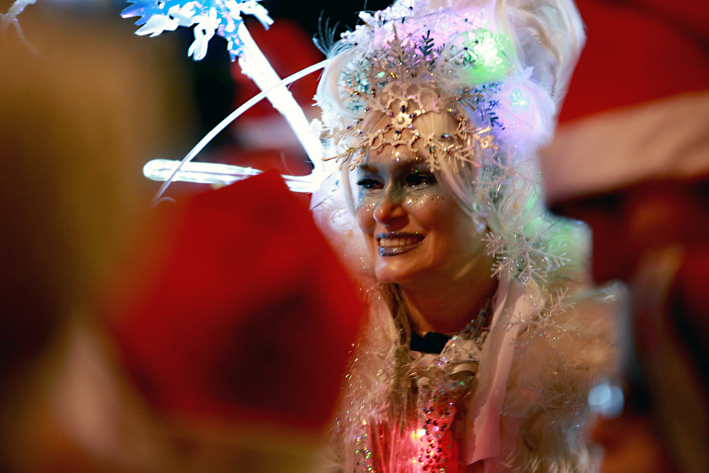 . Melinda Rivers, also known as Mrs. Snowflake, glows amongst attendees of the Festival of Lights Lighting Ceremony in Loveland, Colo. on Nov. 30, 2018.