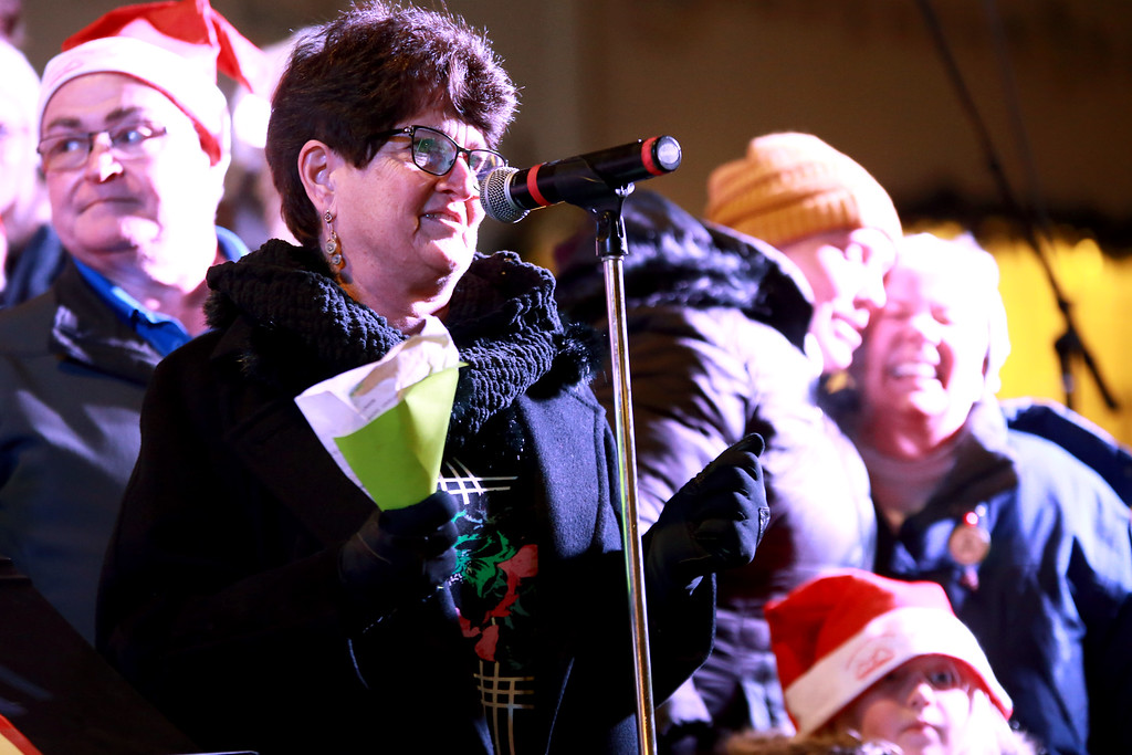 . Mayor Jacki Marsh stands with the choir during Christmas celebration at the Festival of Lights Lighting Ceremony in Loveland, Colo. on Nov. 30, 2018. Photo by Taelyn Livingston/ Loveland Reporter-Herald