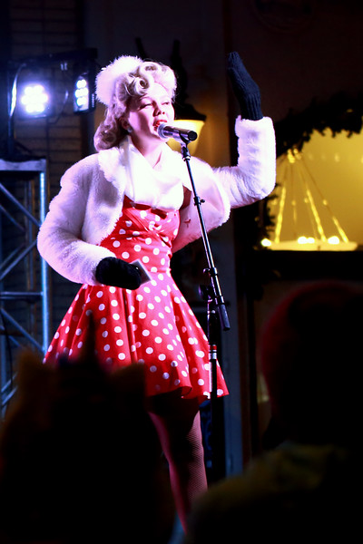 Lexi Van De Walker from the Beverly Belles singing group sings during the Festival of Lights Lighting Ceremony in Loveland, Colo. on Nov. 30, 2018.<br /> Photo by Taelyn Livingston/ Loveland Reporter-Herald