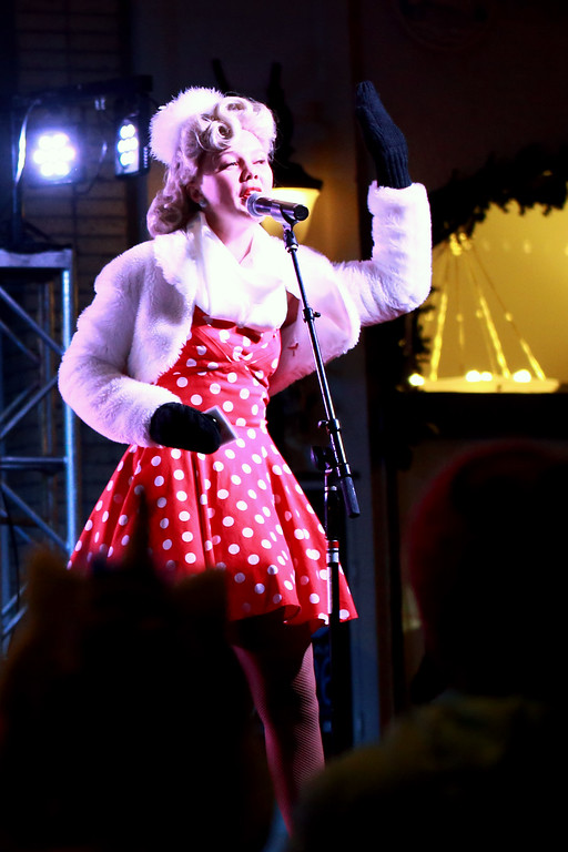 . Lexi Van De Walker from the Beverly Belles singing group sings during the Festival of Lights Lighting Ceremony in Loveland, Colo. on Nov. 30, 2018. Photo by Taelyn Livingston/ Loveland Reporter-Herald