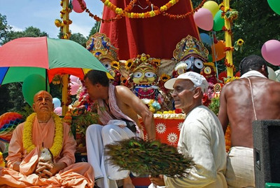 All three Deities are now on board. Swami Prabhupada must be kept cool as the procession takes place over a long period in the hot sun.