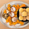 Hindu festival of lights, Dusshera and Diwali preparation and celebration ingredients- sweets, flowers, lights, cash, bell and splash cymbals and incense sticks
