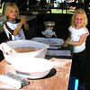 Debbie Blank | The Herald-Tribune<br /> Batesville girls Imogen Trainor (left), 6, and Macie Mobley, 4, learn how to grind oats into flour in one of two Pioneer Living Tents organized by Batesville Memorial Public Library staffers.
