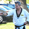 Christopher Aune | The Herald-Tribune <br /> Tae kwon do instructor Jim Bruns demonstrates form at Applefest.