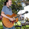 "Debbie Blank | The Herald-Tribune<br /> Guitarist Michael Kelsey, Indianapolis, who is starting to gain national attention, kept the crowd entertained for two hours Saturday afternoon during a performance sponsored by the Batesville Memorial Public Library. He started his set with ""In Your Eyes,"" then later sang ""Pink Cadillac,"" ""Street With no Name"" and some original tunes."