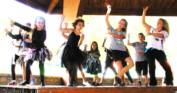 Debbie Blank | The Herald-Tribune<br /> The Southeastern Indiana YMCA dance troupe took the pavilion stage Sunday afternoon. They even performed some dance moves in the aisles to get closer to the audience.