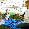 In a Pioneer Living Tent, Batesville brothers Wyatt (from left), 2, and Levi Essick, 4, learn how to play washboards in time to guitar music by Lori Trimble, Sunman.