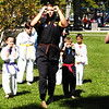 Debbie Blank | The Herald-Tribune<br /> Southeastern Indiana YMCA tae kwon do instructors and students warm up before a demonstration.