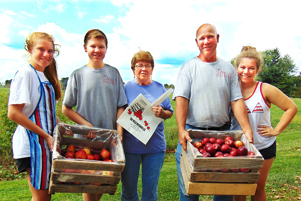 Debbie Blank | The Herald-Tribune<br /> Dave Eckstein (second from right), mom Julie Eckstein (center) and his and Judy's kids (from left) Mindy, 15; Kyle, 17; and Courtney, 21 (Curt is at Purdue now), are among about two dozen family members who worked feverishly at Villa Orchard, Oldenburg, to bring apples and apple products to Applefest. They are holding two varieties, Jonathan and Empire. The Kiwanis Club of Batesville fest was Sept. 23-24, 2017, at Liberty Park.