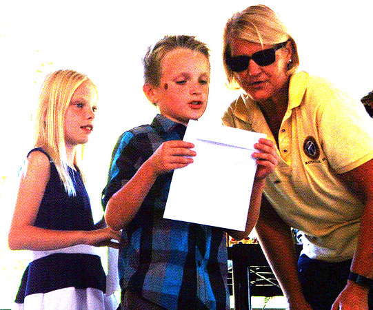 Debbie Blank | The Herald-Tribune<br /> Queen and king nominators (from left) Karsyn Watson and Aiden Greiwe practice their speeches with Kiwanis Club of Batesville President Dr. Jere Schoettmer.