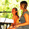 Debbie Blank | The Herald-Tribune<br /> Stella Maple (left) played several solo and duet piano compositions with teacher Shannon Kramer Mullins of Miss Shannon's Music Studio. Other students performed as well on the pavilion stage. More live music included Oldenburg Academy Singers; Highland Reign, an Indianapolis Scots/American folk rock band; and Batesville's Eureka Band.