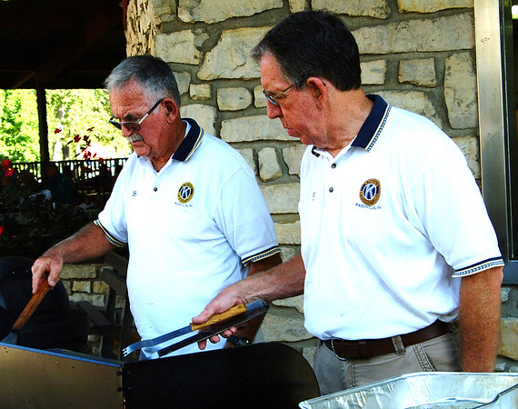 Debbie Blank | The Herald-Tribune<br /> Bob Fitzpatrick (left) and Ed Krause grill pork tenderloins for sandwiches, one of several Kiwanis Club of Batesville options.