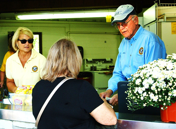Debbie Blank | The Herald-Tribune<br /> Kiwanis Club of Batesville President Dr. Jere Schoettmer (left), member Nelson French and many other Kiwanians grilled and served a nonstop menu of burgers, hot dogs, brats, metts, apple sausages and pork tenderloin sandwiches.