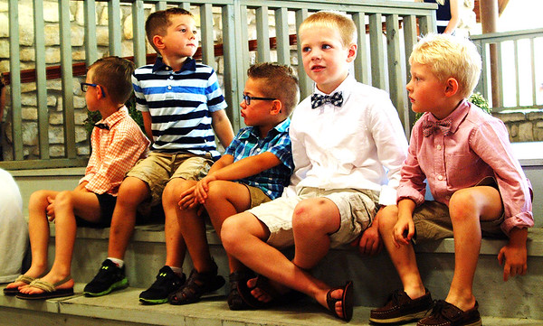 Debbie Blank | The Herald-Tribune<br /> Five of nine kindergartners in the running for Mr. Apple Bud gather before the contest in the Liberty Park Pavilion. They are (from left) Mason Leising, George Miller, Lincoln Rak, Nolan Gesell and Noah Bastin.